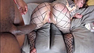 Tattooed girl in fishnet pantyhose riding black dick